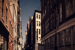 NarrowStreetInDowbntownManhattan_squished_1600