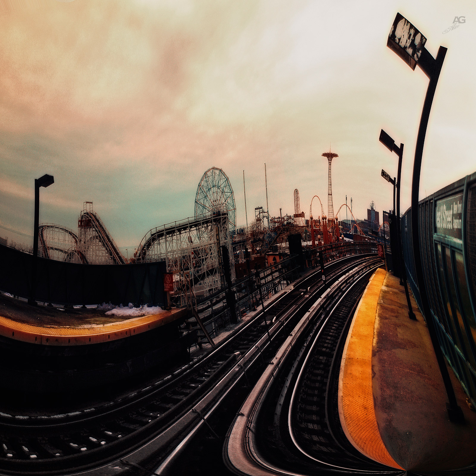 ElevatedTrainSubwayPlatformWithConeyIslandAttractionsOnABackgroundCloudy_unfolderWarp_1600