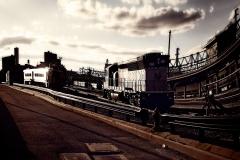 RailTracksOnHobokenTrainStationAndDramaticLocomotive_warped