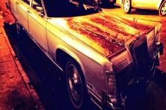 VintageLincolnCarNightVillageStreet_warped_1600